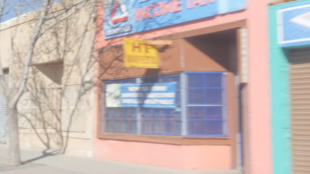 Driving Past Colorful Closed Border Town Store Fronts video