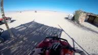 driving the ATV in the desert. video