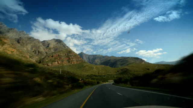 Driving through scenic and sunny South African, Western Cape mountain pass, daytime video