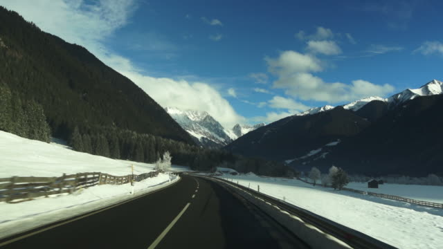 HD Driving through Winter Mountain Landscape video