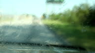 Driving. Transportation. View through vehicle windshield. Traveling down highway. video