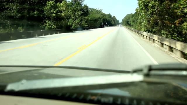 Driving. Transportation. View through vehicle windshield. Traveling down Texas highway. video