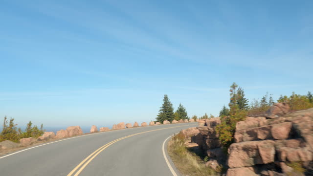 POV: Driving up the mountain along the double yellow line winding coastal road video