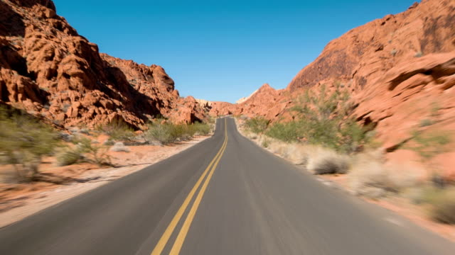 Driving USA: Lonely empty highway through red sandstone formations in Valley of Fire, Nevada video