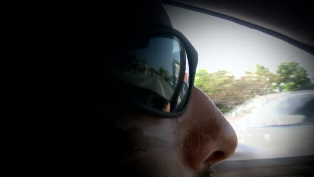 Driving,traffic reflection on the sunglasses video