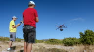 Drone being airborne by two pilots video