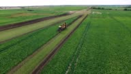 Drone flight aerial bird eye view of tractor blue sky in the background helicopter view and using very high resolution 4k camera video