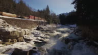 Drone Floating Backwards Over Icy Eagle Falls by Highway 2 and Moving Train video