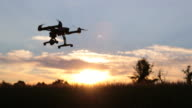 Drone flying at sunset over a field video