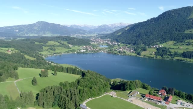 Drone flying in Allgäu German Alps and over Großer Alpsee Lake video