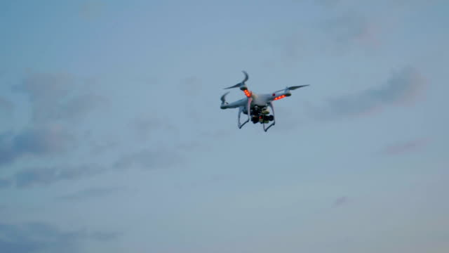 Drone flying in the evening sky with clouds video