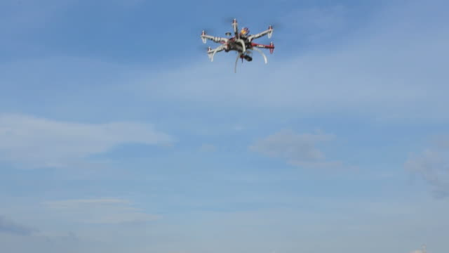 Drone flying in the sky, view from the bottum up video