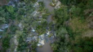 Drone flying over running stream video