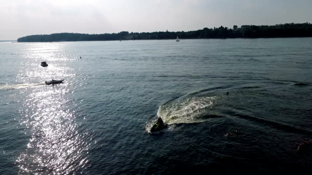 Drone flying over water surface video