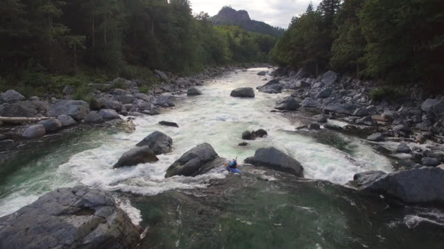 Drone Follows Extreme Kayaker Down Raging River in Mountain Forest video
