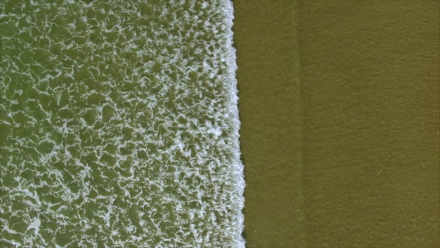 Drone footage of waves splashing on shore video