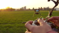 SLOW MOTION CLOSEUP: Drone operator holding a transmitter video