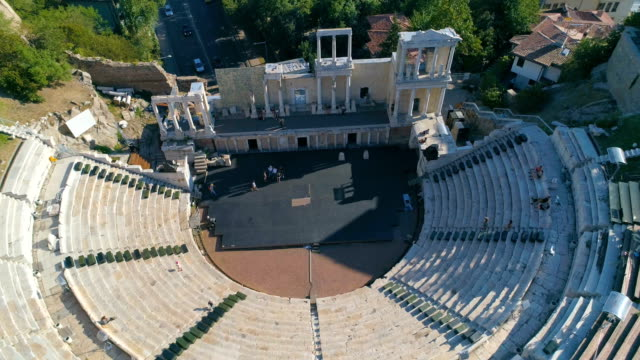Drone panning shot of the ancient roman amphitheater in the old town of Plovdiv, Bulgaria video