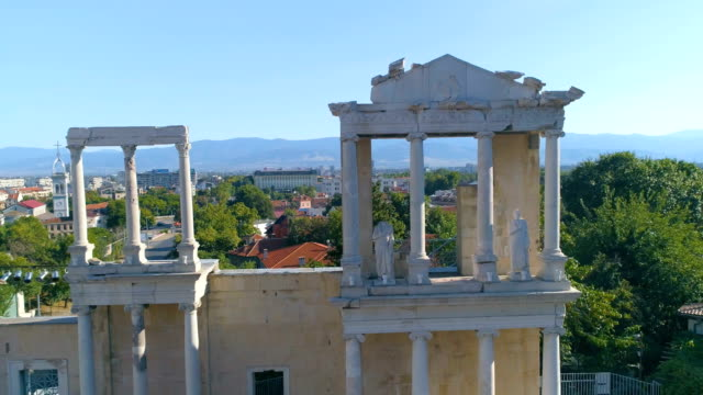 Drone panning shot of the columns of an ancient roman amphitheater in the old town of Plovdiv, Bulgaria video