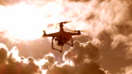 drone quad copter with digital camera flying hovering on sunset video