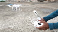 drone quad copter with digital camera flying hovering video