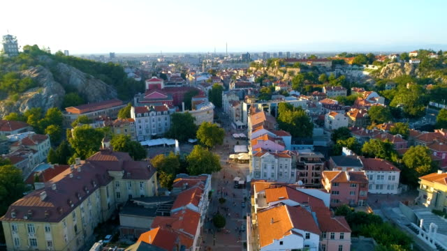 Drone reveal shot flying over the main street in downtown district of Plovdiv city in Bulgaria video