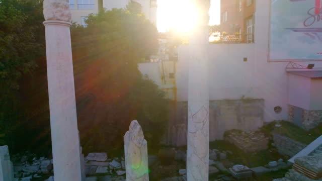 Drone shot 360 degree rotation around old roman columns video
