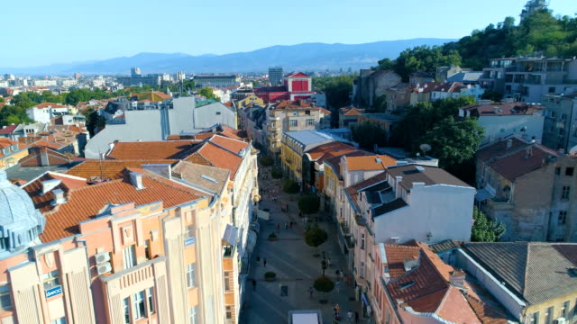 Drone shot flying over downtown main street district of the city of Plovdiv in Bulgaria video