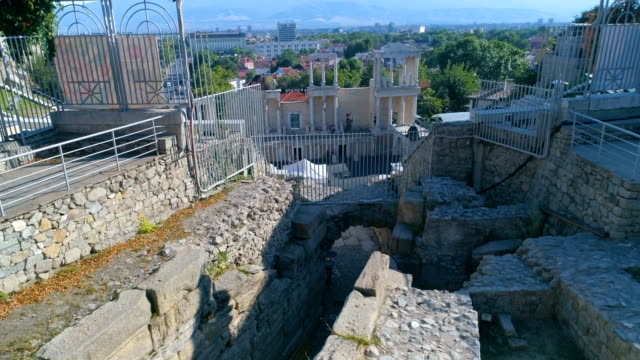 Drone shot of an ancient roman amphitheater in the old town of Plovdiv city in Bulgaria video
