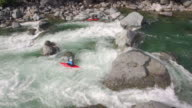 Drone Shot of Kayaker Charging Down Raging River on Sunny Day video