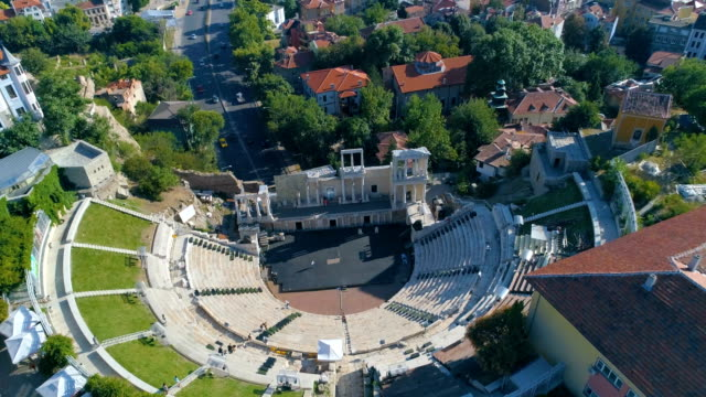 Drone shot revealing ancient roman amphitheater in the old town of Plovdiv city in Bulgaria video