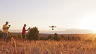 DS Drone taking off into air at sunset video