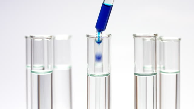 Drop blue liquid in test tube with water video
