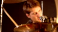 Drummer. Close-up on a hi-hat & drum kit aggressively played by a unsharp male. video