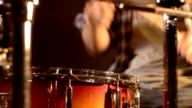 Drummer. Close-up on a snare drum aggressively played by a unsharp male. video