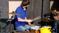 Drummer playing on drums in recording studio video