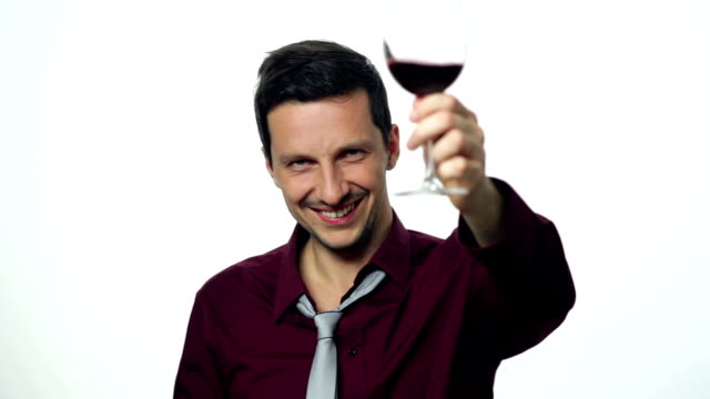 Drunk businessman toasting with glass of wine video