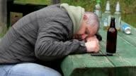 Drunk men sleeping on table video
