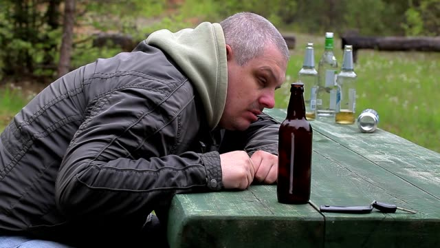 Drunk men with bottle of alcohol at outdoor video