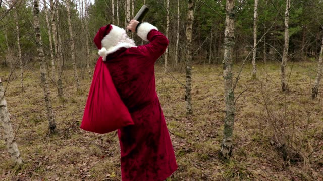 Drunk Santa Claus with empty bottle video