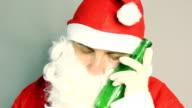 Drunken santa claus sleeping with beer in hand video