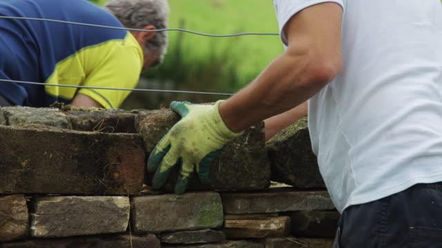 Dry Stone Wall Builders Testing Blocks video