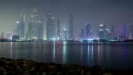 Dubai Marina skyline as seen from Palm Jumeirah, Dubai, UAE.  Timelapse video