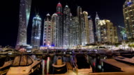 Dubai Marina with skyscrapers and boats Hyperlapse video