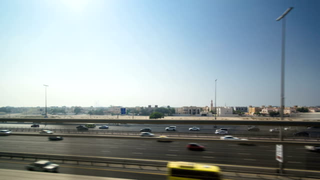 Dubai Metro. A view of the city from the subway car on road, Dubai, UAE. Timelapse video