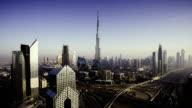 Dubai sky line with traffic junction and Burj Khalifa video