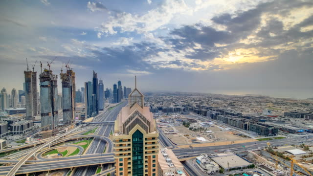 Dubai skyline timelapse at sunset with beautiful city center skyscrapers and Sheikh Zayed road traffic, Dubai, United Arab Emirates video