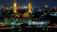 Dubai skyline with Mosque illuminated at night timelapse. Dubai, United Arab Emirates video