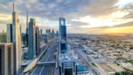 Dubai skyscrapers sunset timelapse evening time. Dubai Metro station and traffic on Sheikh Zayed Road video