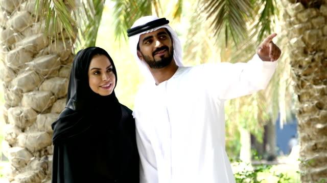Dubai - Traditional Emirati young couple outside video